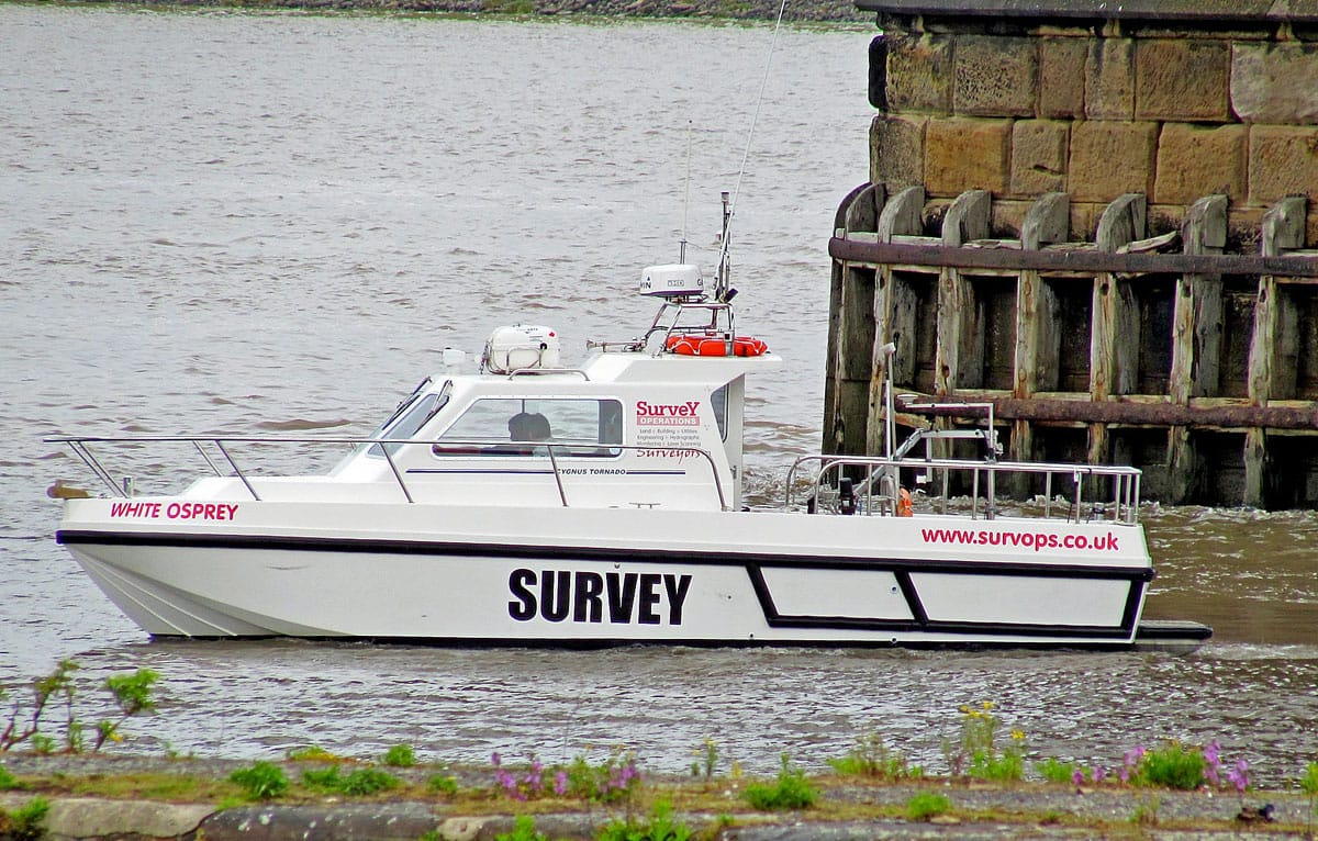 Survey Operations surveying using a boat.