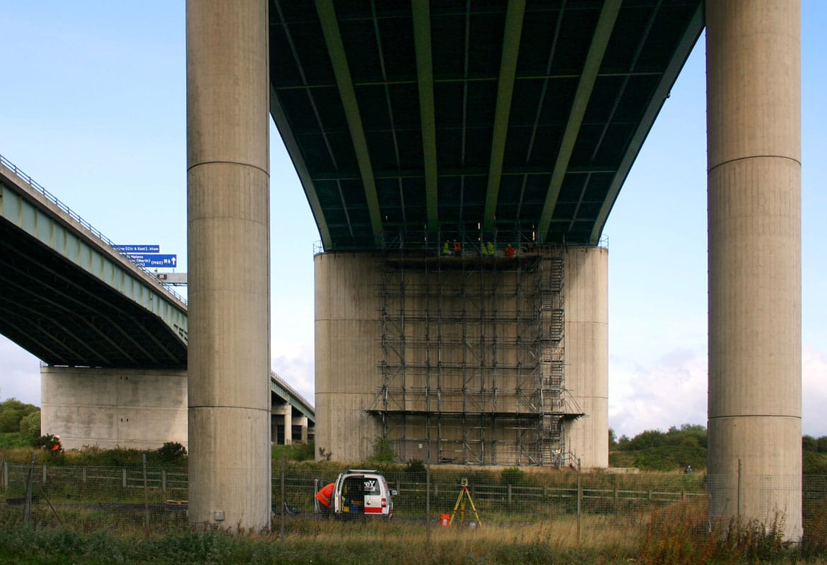 Survey Operations performing engineering survey under the Thelwall Viaduct bridge under the M6 motorway.
