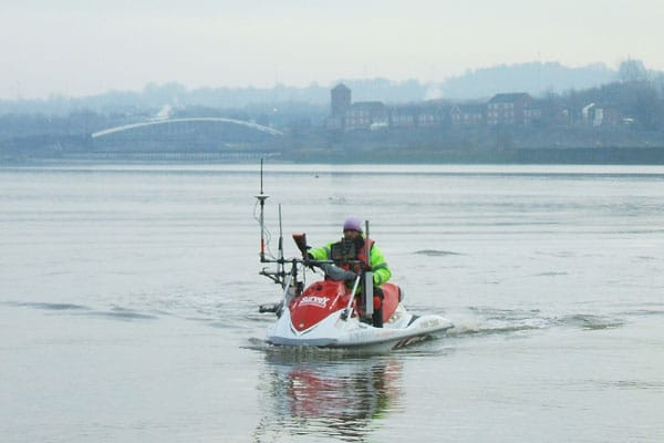 Image of Survey Operations Surveour on a jet ski.