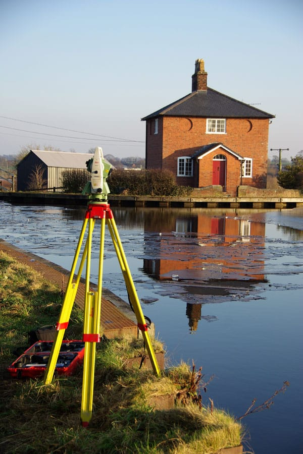 Surveying on a canal bank