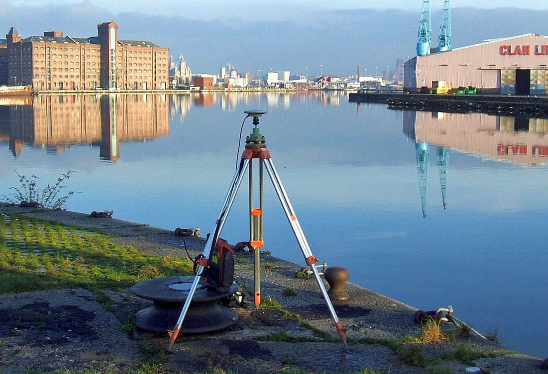 Suvery Operations GNSS survey near a body of water.