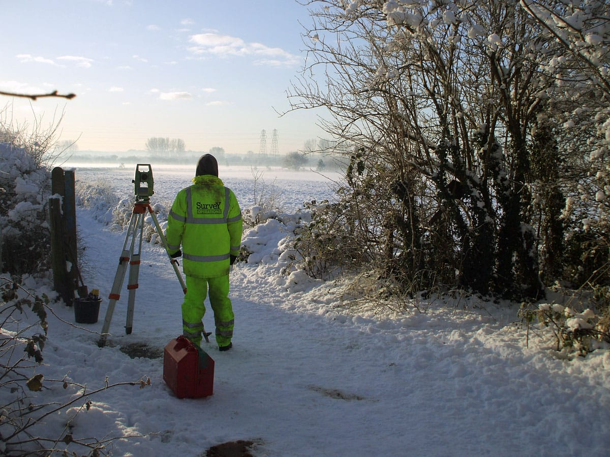 Survey operations surveying in snow