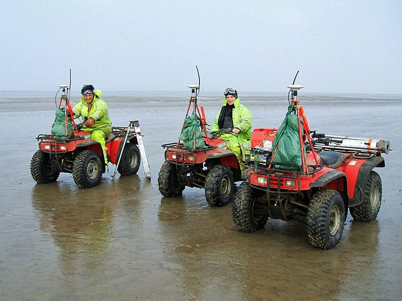 Survey Operations staff on quad bikes.