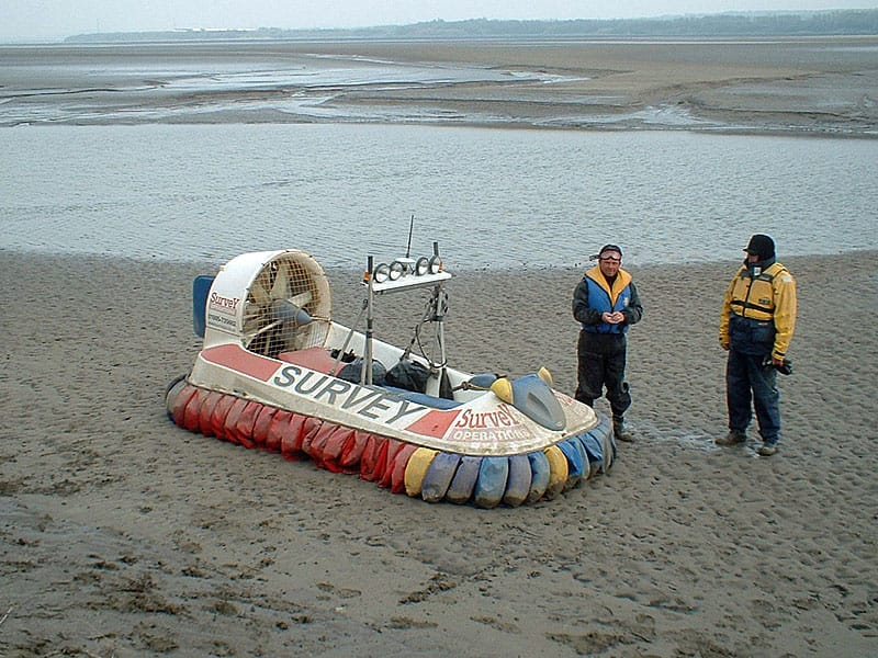 Survey Operations staff with a hovercraft.
