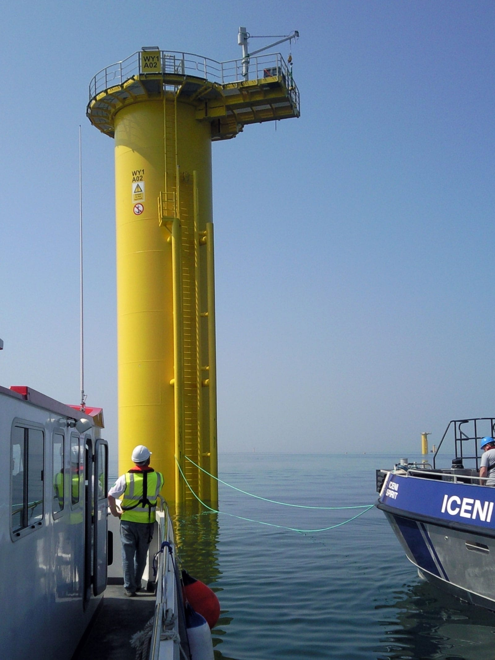 Survey Operations staff completing precise levelling survey from a boat.