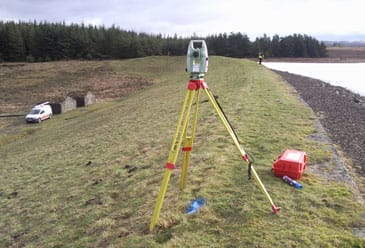 Survey Operations surveyor using equipment to gauge precise levelling.
