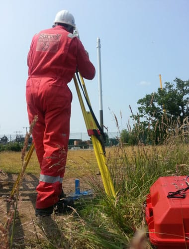 `Survey Operations staff using equipment to measure structual movement.