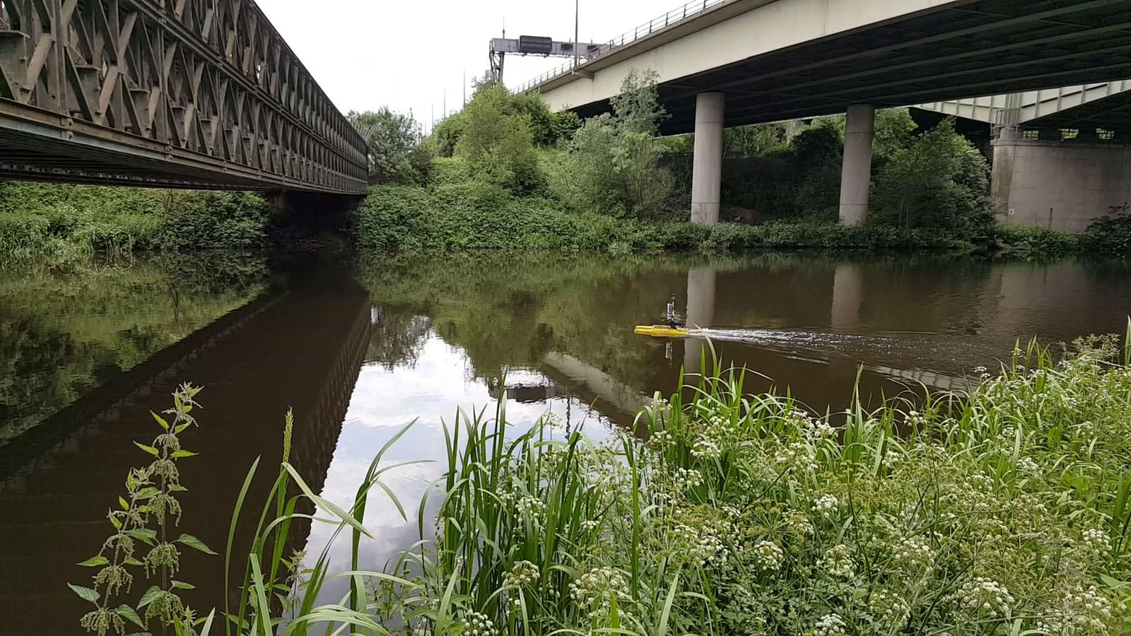 Surveying a river under the Thelwall Viaduct.