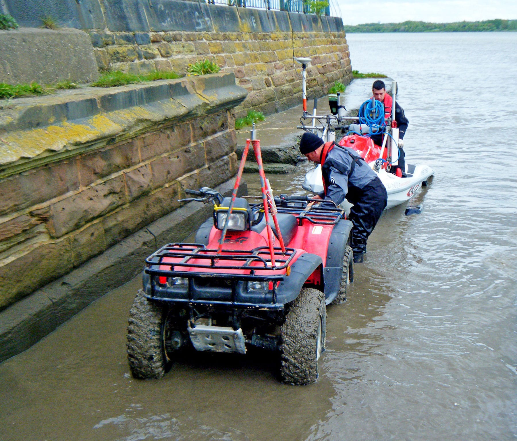 Quad bike nad jet ski used for surveying a river.