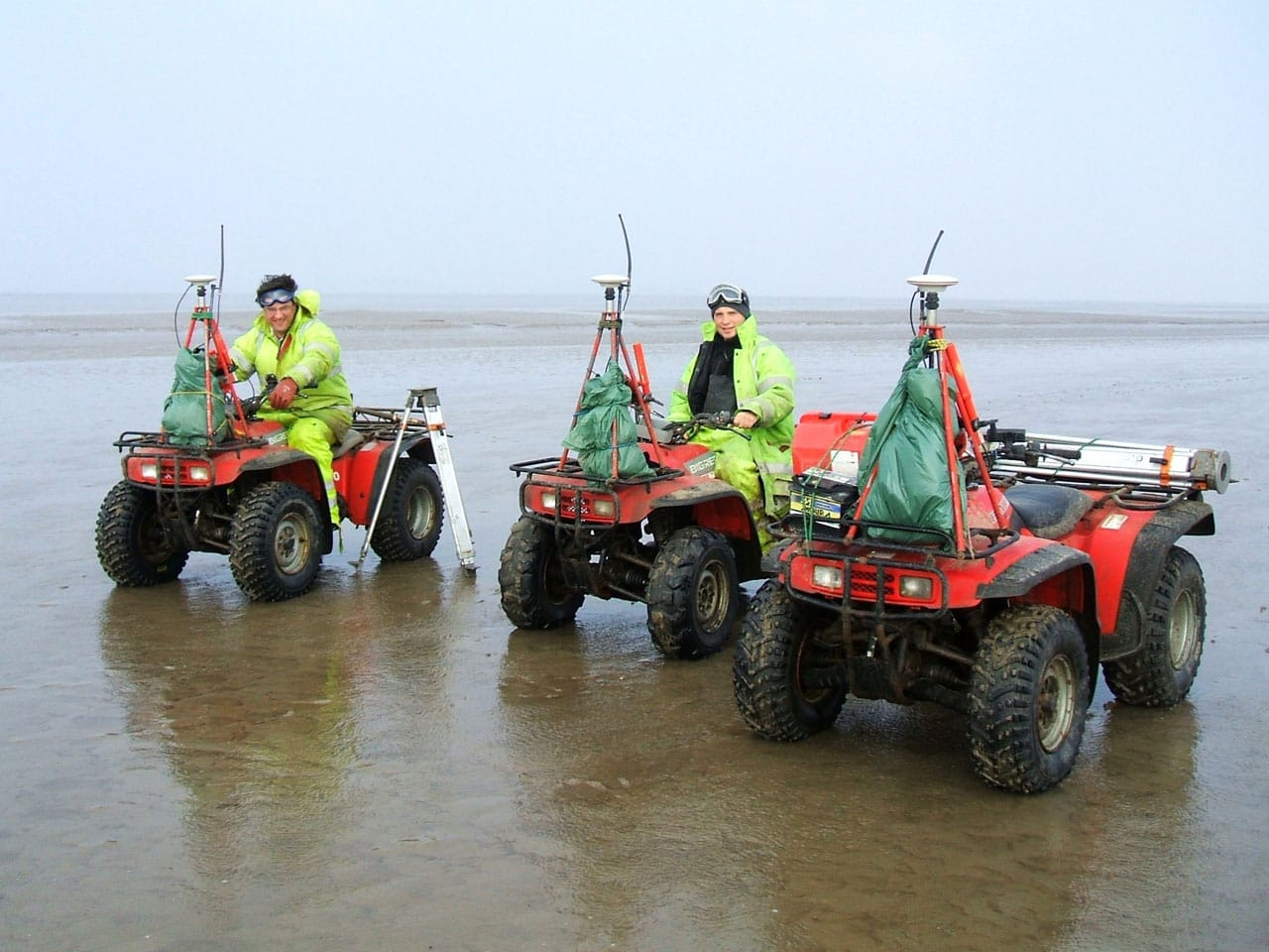 Image of Survey Operations staff on quad bikes.